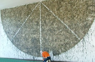 Richard Long and his work on the Glove Factory wall - image copyright